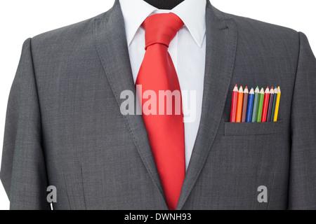 Close-up de crayons de couleur dans la poche de manteau Banque D'Images