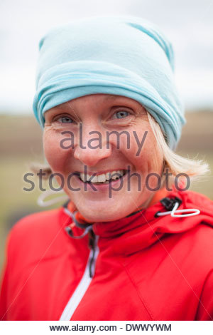 Portrait of happy young woman wearing bandana outdoors Banque D'Images