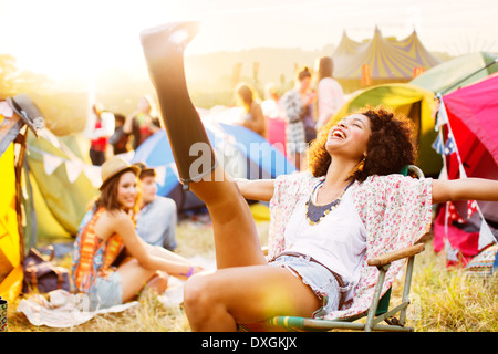 Carefree woman outside tents at music festival Banque D'Images