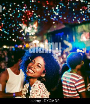 Portrait of enthusiastic woman at music festival Banque D'Images