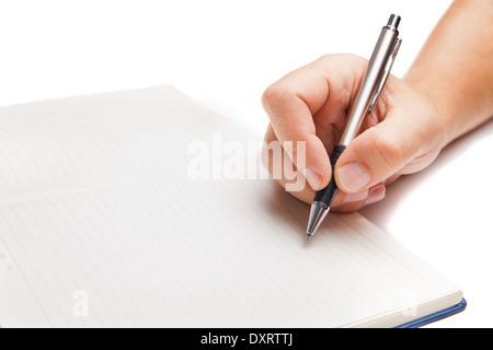 Man main écrit en livre ouvert isolé sur fond blanc Banque D'Images