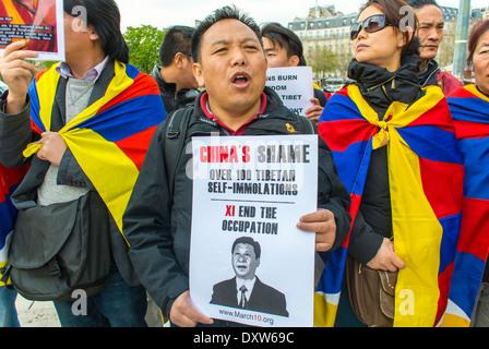 Foule, le tibétain, le taïwanais communautés ethniques de la France, et les amis ont appelé à des citoyens français à se mobiliser au cours de la visite du président chinois Xi Jinping à Paris, les manifestations de défense des droits des citoyens