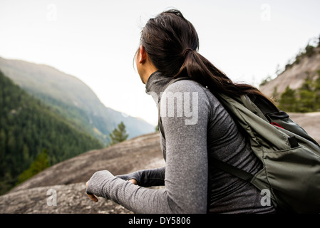 Young woman looking at view, Squamish, British Columbia, Canada