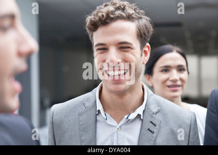 Businessman laughing avec des collègues Banque D'Images