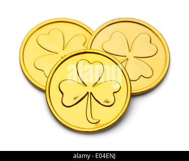 Trois pièces d'or avec trois lames Desgin Trèfle isolé sur fond blanc. Banque D'Images