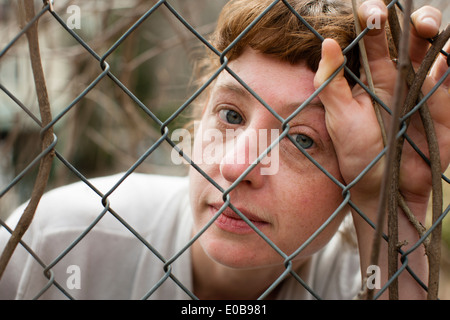Woman behind fence