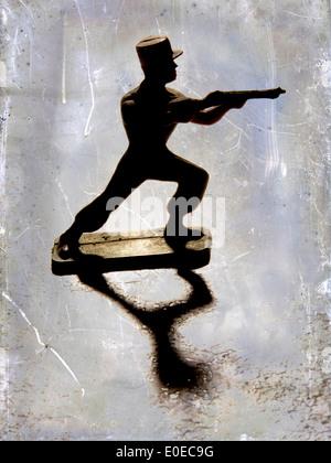 Figurine soldat tirant son pistolet Banque D'Images
