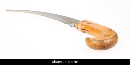 Old rusty toy scie à main sur fond blanc Banque D'Images