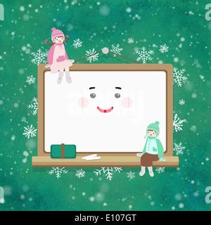Une fille et un garçon jouant avec un ordinateur portable Banque D'Images