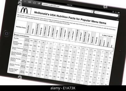 Apple ipad mini avec 'mcdonald's usa la valeur nutritive de certains éléments de menu populaire' Banque D'Images