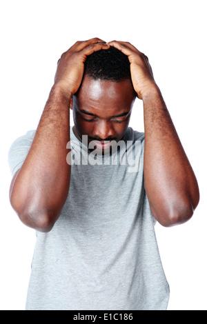 Homme africain ayant maux isolé sur fond blanc Banque D'Images