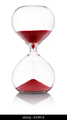 Avec Hourglass dans sable rouge Banque D'Images