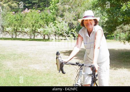 Portrait of senior woman cyclist in park