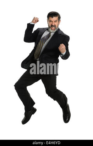 Hispanic businessman jumping for joy isolé sur fond blanc Banque D'Images