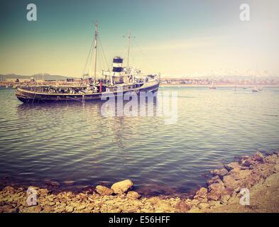 Vintage photo de vieille épave dans le port. Banque D'Images