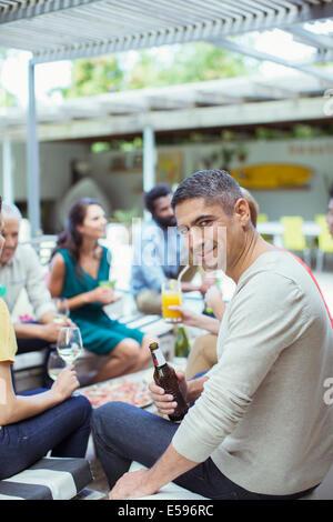 Man smiling at party
