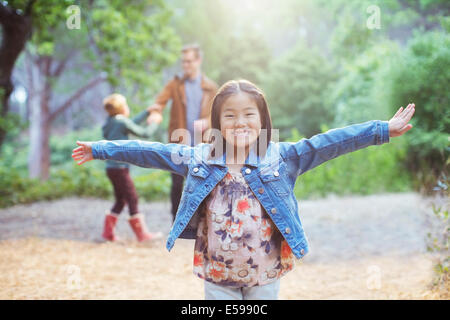 Girl cheering in forest Banque D'Images
