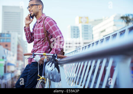 Man talking on cell phone on city street