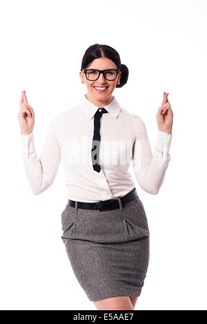 Happy woman wearing glasses with crossed fingers, Debica, Pologne Banque D'Images