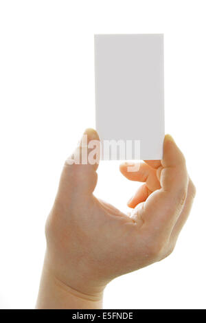 Hand holding blank business card isolé sur fond blanc Banque D'Images