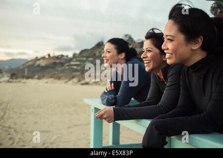 Joggers enjoying view on beach