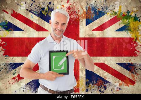 Image composite de l'étudiant adulte montrant tablet pc Banque D'Images