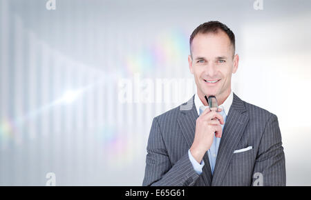 Portrait of businessman holding glasses Banque D'Images