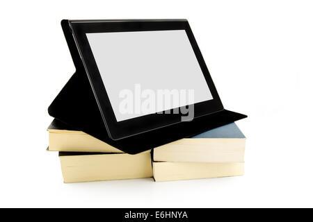 Façon moderne de lecture du concept. Livres et d'un stylet. Banque D'Images
