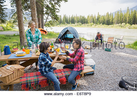 Family relaxing together at campsite Banque D'Images
