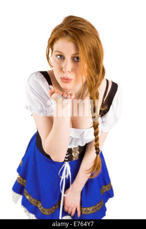 Oktoberfest girl blowing a kiss Banque D'Images