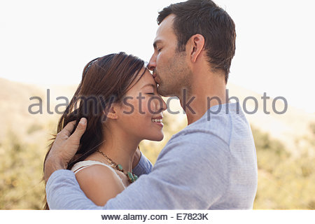 Close up of couple kissing Banque D'Images