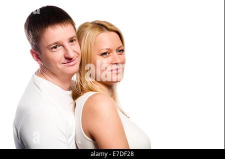 Jeune couple dans l'amour sur fond blanc Banque D'Images