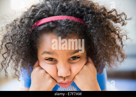 Close up of African American girl making a face