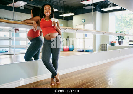 Young woman smiling in yoga studio
