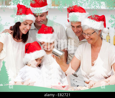Image composite de happy family baking christmas cakes Banque D'Images