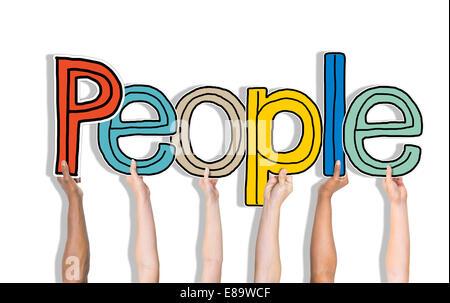 Groupe multiethnique de mains tenant parole Personnes Banque D'Images