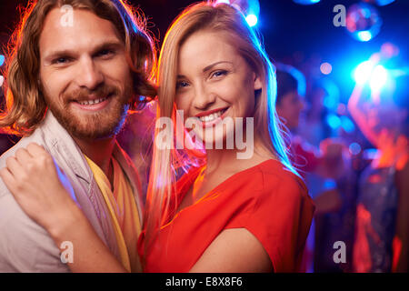 Happy senior couple at party Banque D'Images