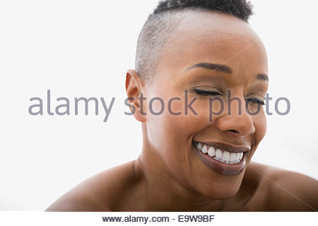 Close up of woman laughing with eyes closed Banque D'Images