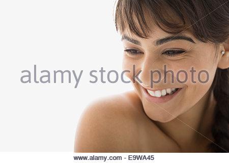Close up of smiling torse nu brunette woman Banque D'Images