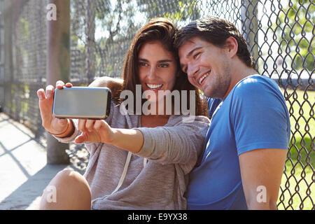 Couple par selfies wire fence