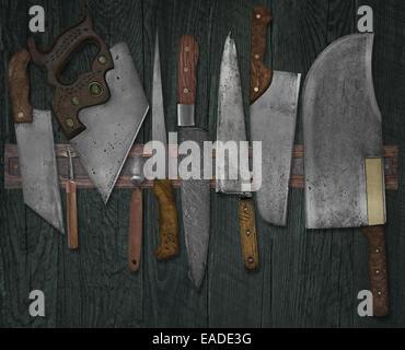 Vintage jeu de couteaux sur le rack de l'aimant contre mur, couleurs fanées Banque D'Images