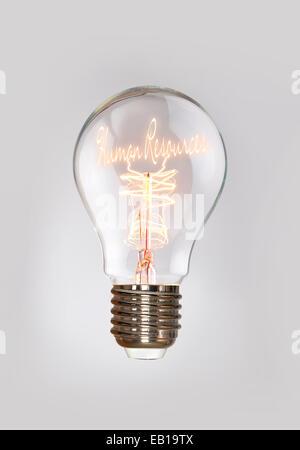 Concept des ressources humaines dans une ampoule à incandescence. Banque D'Images