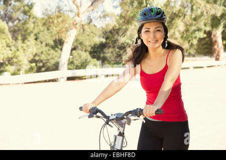 Portrait of mature female cyclist in park
