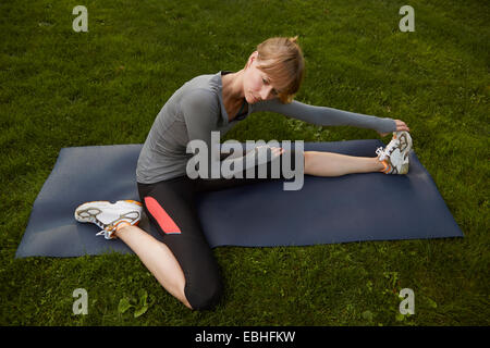 Mid adult woman practicing yoga in park