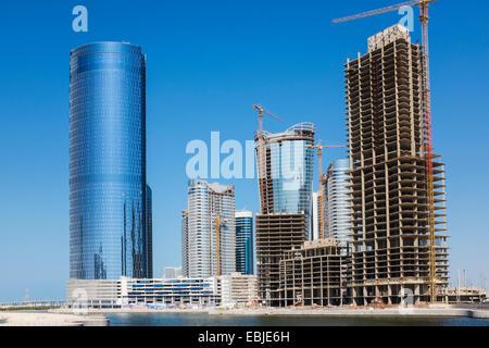Des tours d'habitation modernes et immeubles de bureaux en construction à Ville des Lumières sur Al Reem Island Banque D'Images