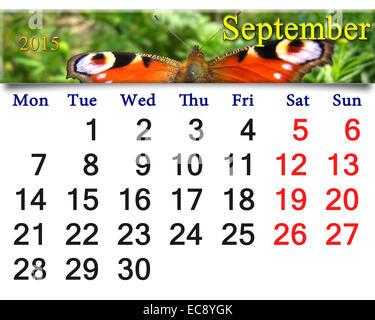 Beau calendrier pour septembre de l'année 2015 avec l'image de l'œil de paon papillon