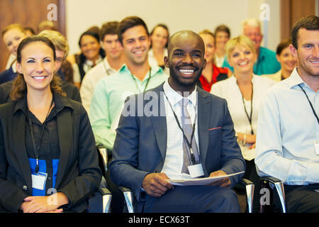 Smiling businessman sitting in conference room, looking at camera Banque D'Images