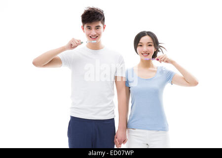 Jeune couple se brosser les dents Banque D'Images