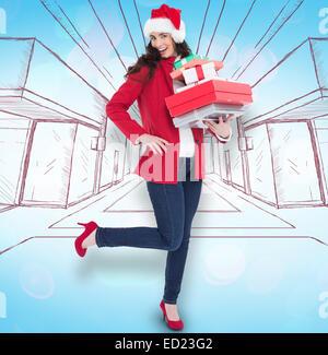 Image composite de brune en robe rouge tenant de nombreux cadeaux Banque D'Images