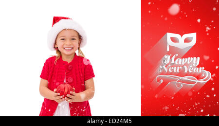 Image composite de cute little girl wearing santa hat holding bauble Banque D'Images